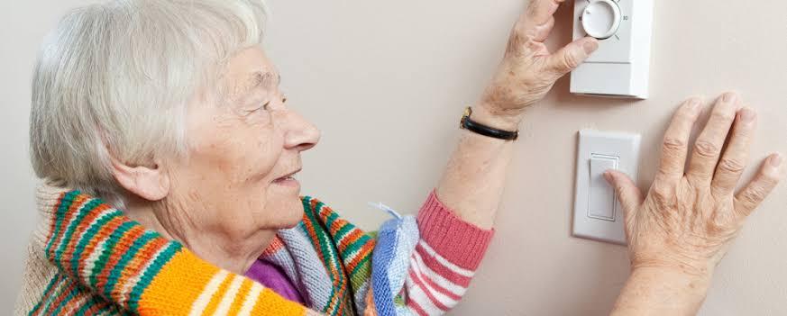 lady-adjusting-alarm-system